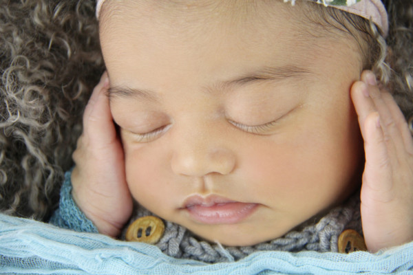 Beautiful close up picture of baby Florence in pale blue