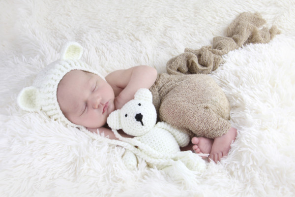 New born Aubrey in white with teddy