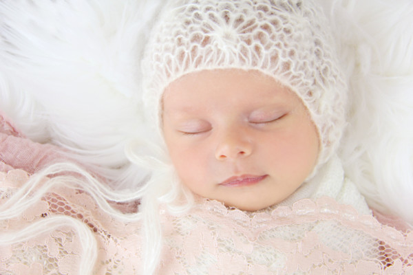 Photography of newborn baby Mila in cream and pink